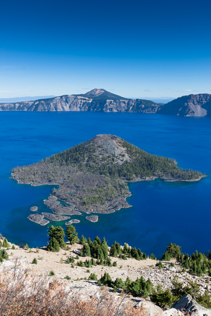Crater Lake in Oregon featuring Wizard Island near its middle is the deepest and bluest lake in the United States.