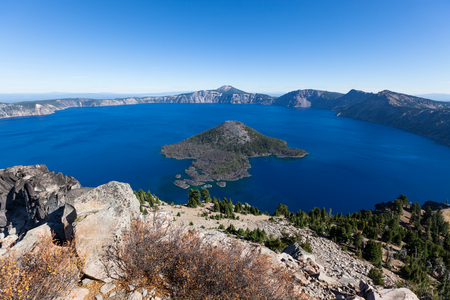 Deep blue water surrounds Wizard Island and is contained in what remains of Mount Mazama now called Crater Lake National Park in Oregon.