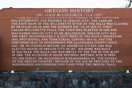OREGON CITY, OREGON - April 11, 2014:  A wooden sign with historical information on Dr. John McLoughlin at the Willamette Falls viewpoint in Oregon City, OR on April 11, 2014. Editorial