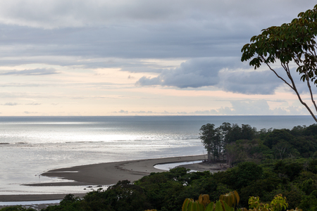 peaceful view of the horizon stretching across the pacific ocean in Costa Rica as the sky begins to change into pastel colors with the setting sun Reklamní fotografie