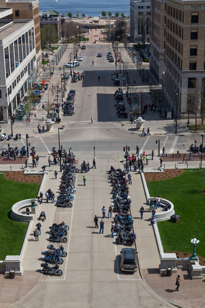 MADISON, WISCONSIN - May 10, 2014: A group of motorcycles parked at the capital building across from Martin Luther King Jr Blvd for motorcycle awareness month  in Madison, WI on May 10, 2014. Editorial