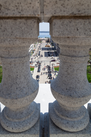 MADISON, WISCONSIN - May 10, 2014: Looking through a roof railing to a group of motorcycles parked at the capital building across from for motorcycle awareness month  in Madison, WI on May 10, 2014.