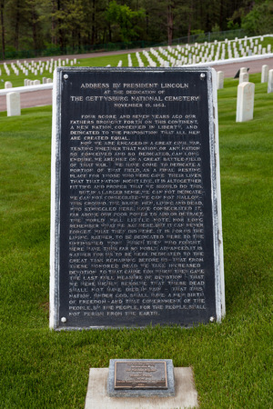 HOT SPRINGS, SOUTH DAKOTA - June 8, 2014:  A large plaque reciting the Gettysburg Address by President Lincoln and a small plaque from the National Register of Historic Places at the Hot Springs National Cemetery in Hot Springs, SD on June 8, 2014. Editorial