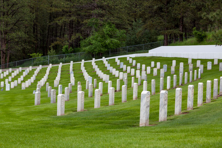HOT SPRINGS, SOUTH DAKOTA - June 8, 2014:  Rows of soldiers white headstones on the hilly slope of Hot Springs National Cemetery in Hot Springs, SD on June 8, 2014. Editorial