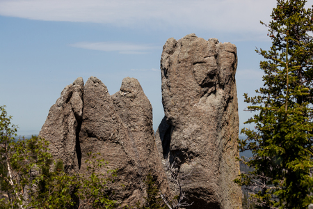 Enormous rock formations against a blue sky in the Cathedral Spires section of Custer State Park, South Dakota.