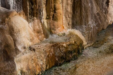 Hot mineral water flowing over a rock pyramid base for over a hundred years has created a travertine structure that continues to grow in Hot Springs State Park, Thermopolis, Wyoming.