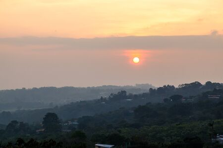Saharan dust affecting the weather and visibility in Costa Rica, view from the central valley as the sun lowers towards the horizon. Stok Fotoğraf