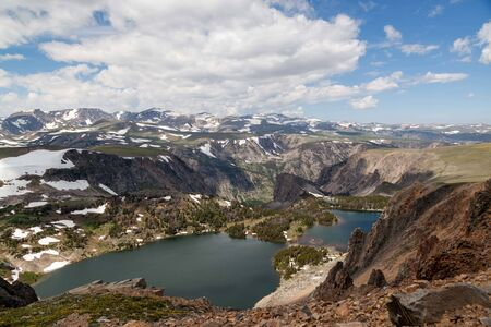 Christmas Lake and the surrounding landscape as seen from the Beartooth Highway in the Shoshone National Forest, Wyoming. Stok Fotoğraf