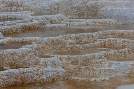 Terraced travertine with hot mineral water pools make up Palette Hot Springs in Yellowstone National Park, Wyoming.