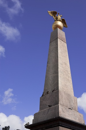Obelisk with a golden double-headed eagle Stock Photo