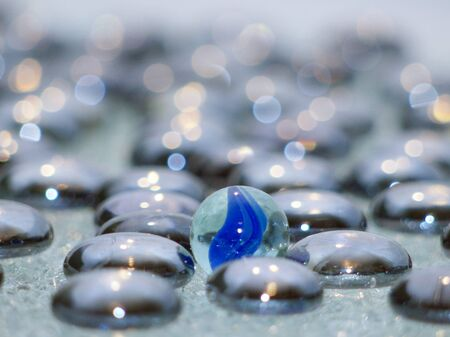Glass pebbles on crystal