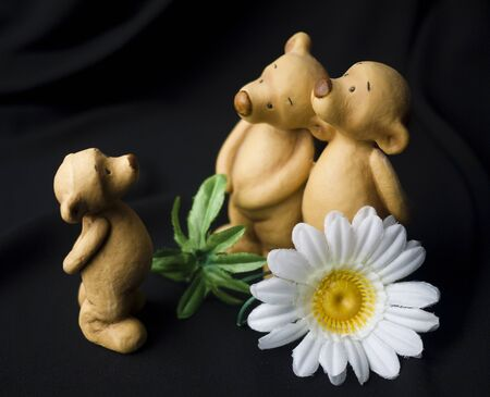 Figurines of bears on a black background