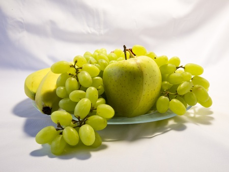 Still life with grapes, apple and banana