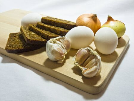 Still life wiht bread, eggs, bulbs and garlic