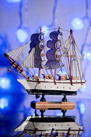 Still life with a sailboat on the background of blue lights Stock Photo - 12017184