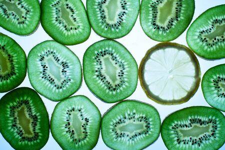 Slices of kiwi fruit and slice of lemon photo