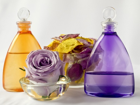 Lavender and arnica oil, rose petals in a glass vase Stock Photo