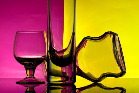 Glass goblets on a colored background abstract Stock Photo