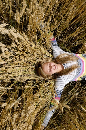Happy, laughing girl in a field
