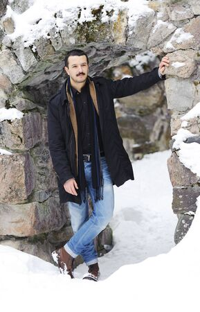 Portrait of a handsome young man in a full-length on the street in winter Stock Photo - 18212087
