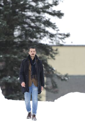 Portrait of a handsome young man in a full-length on the street in winter Stock Photo - 18212037