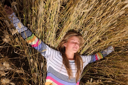 Happy, laughing girl in a field photo