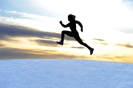 Female athlete running outdoors in winter photo