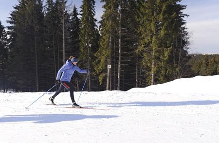 Skier on a walk in the park in winter Reklamní fotografie