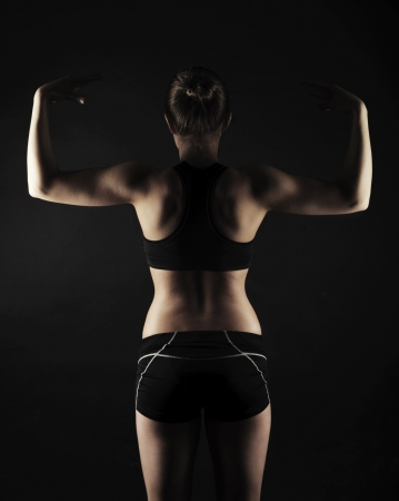 Strong athletic muscular woman in studio