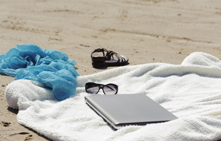 beach wrap: Wrap, laptop, scarf and mules on the beach