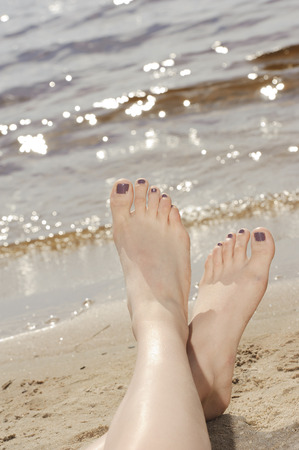 painted toes: Feet in sand on the beach