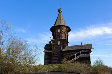 Old wooden church in a village photo