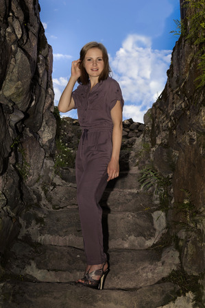 Portrait of young woman in stylish overalls Stock Photo