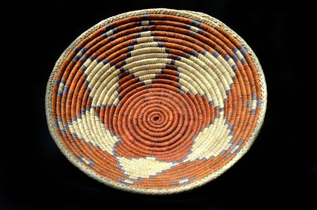 basket: Native American Indian Woven Basket on a Black Background
