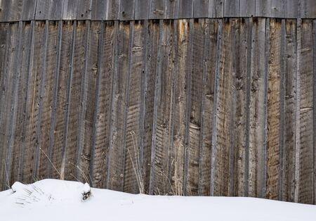 barnwood: Old barn wood siding with snow.