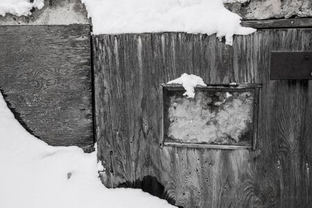 Old cellar buried in the snow.