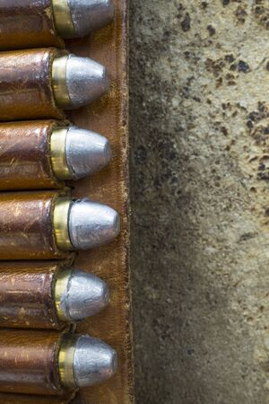45 gun: Detail of a Leather Gun Belt with Colt 45 Bullets Stock Photo