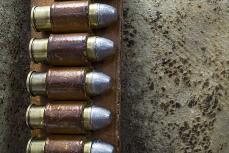 outlaw: Close up Photo of an Old West Bandolier Belt with Colt 45 Bullets