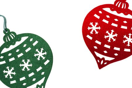 Colorful red and green Christmas ornaments on a white background.
