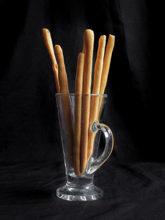 gressins: Homemade bread sticks put in cup on white backgrounds,made from natural ingredients.