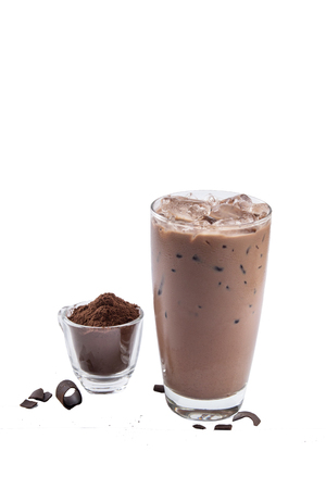 Isolate Iced Chocolate glass on white background with crushed cocoa powder in mini cup. Stock Photo