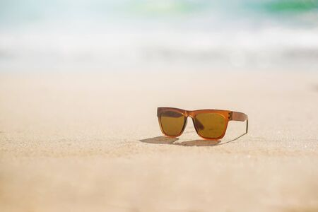Sunglasses on the beach in summer