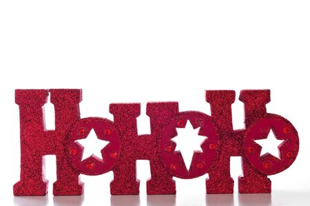 red glittery: Word spells HoHoHo in red glittery letters; isolated on white background.