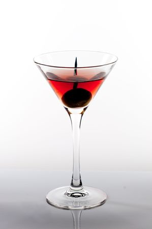 toothpick: Martini glass with toothpick in olive.