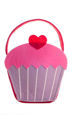 Bag shaped like a cupcake with a heart on top.  Isolated on white background. Stock fotó