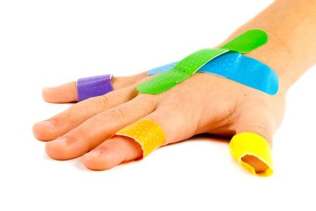 Colorful bandages on child photo