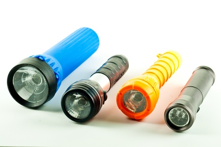 Four different styles of flashlights   Isolated on white