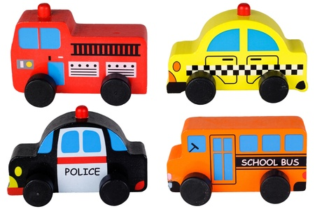 Set of four wooden toy cars isolated on white  photo