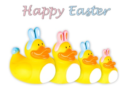 squeaky clean: Rubber duckies with pink and blue Easter bunny ears and tail   Isolated on White  Stock Photo