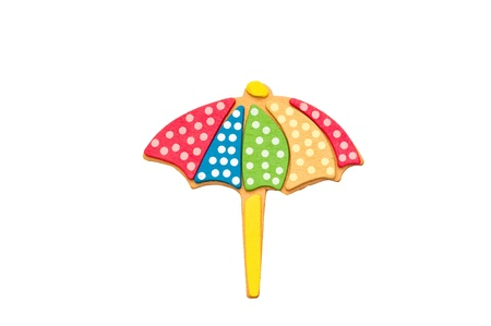 rainy season: Beach umbrella isolated on white background.
